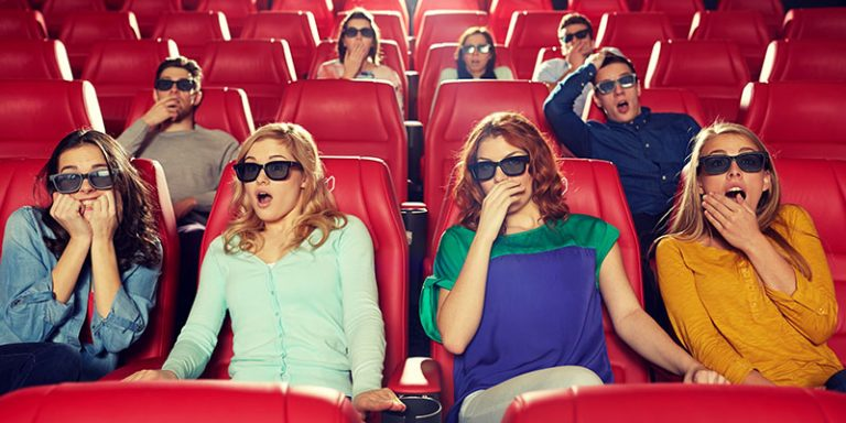 Audience watching a 3D movie