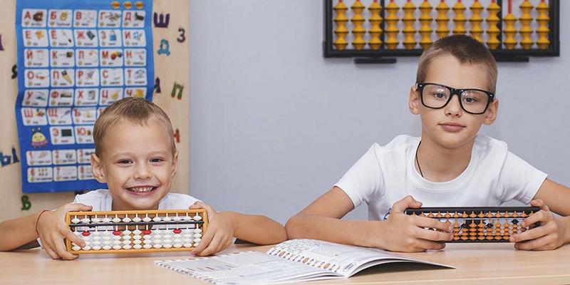Siblings in school studying STEAM